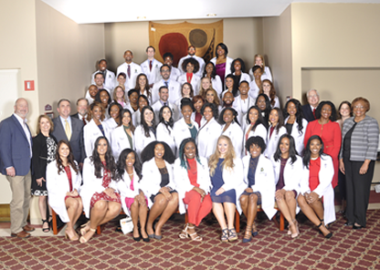 Tuskegee presents white coats to 54 veterinary medicine students
