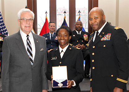 ROTC cadet Granger receives national military medal during commissioning ceremony