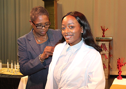 OT, health sciences students receive white coats