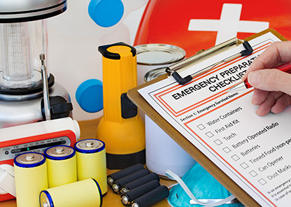 checking a list of emergency preparedness items