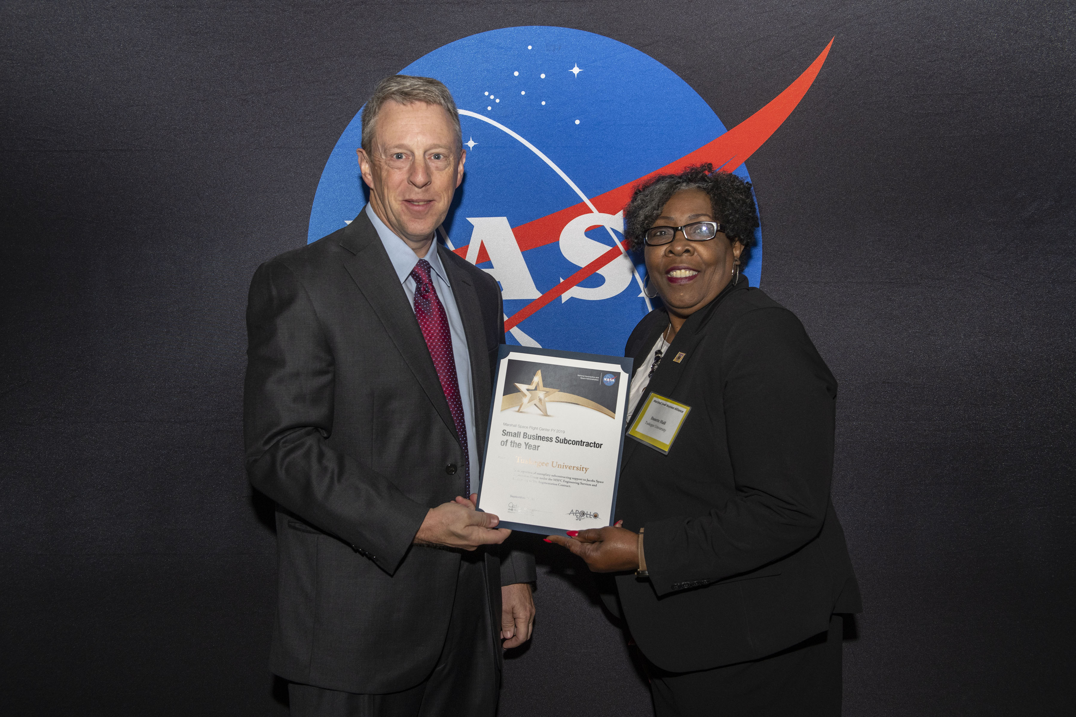 Danette Hall received an award from NASA's Todd Pospisil