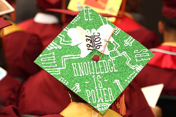 Graduate's decorate cap that reads Knowledge is Power