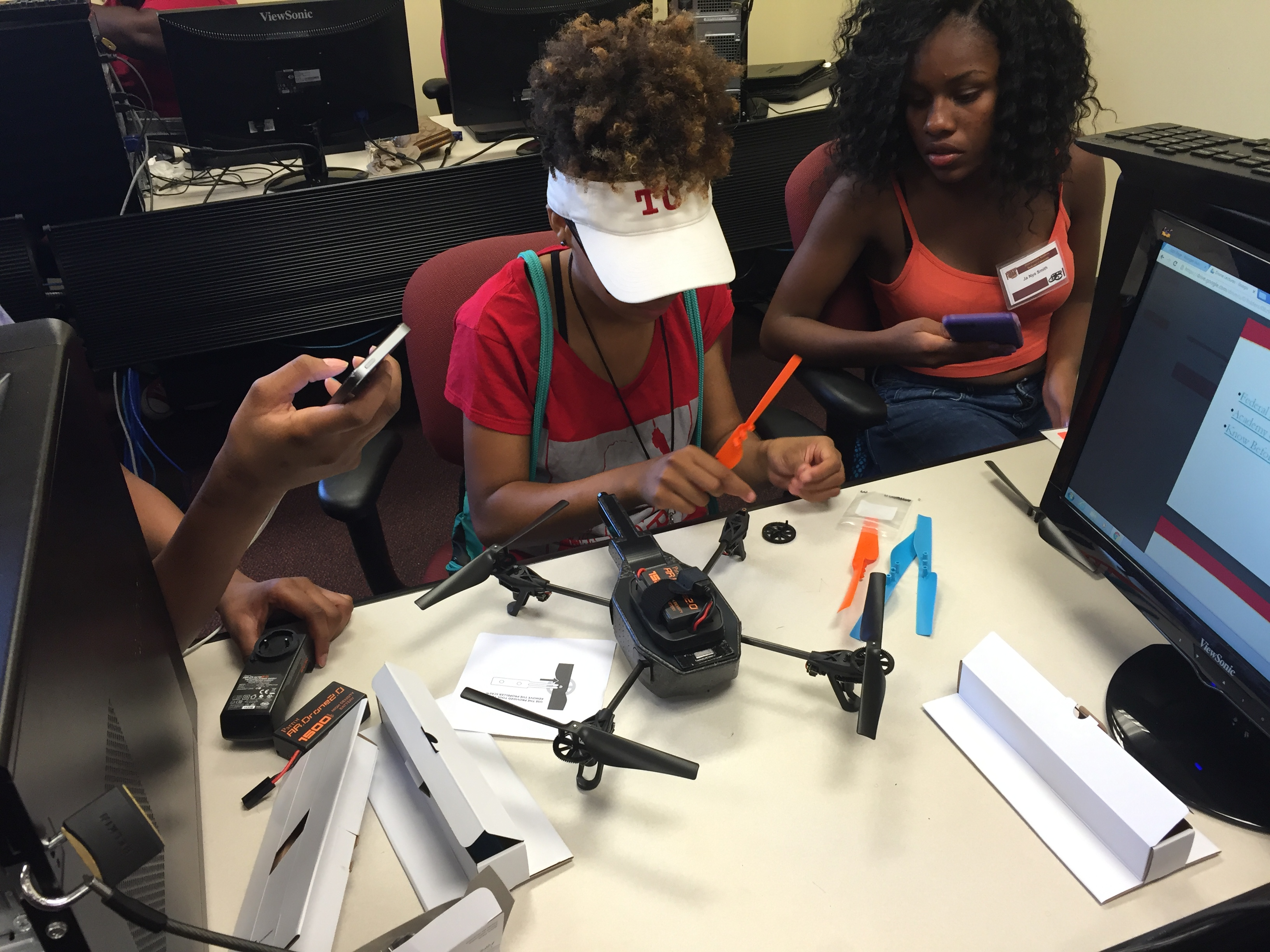 Students assemble drones in lab