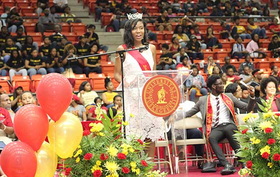Jasmine Roberts, second attendant to Mrs. Tuskegee, speaking to Open House Crowds