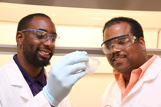 Researchers Curry (right) and White (left) examine discovery.