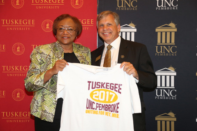 Perry and Cummings hold partnership t-shirt