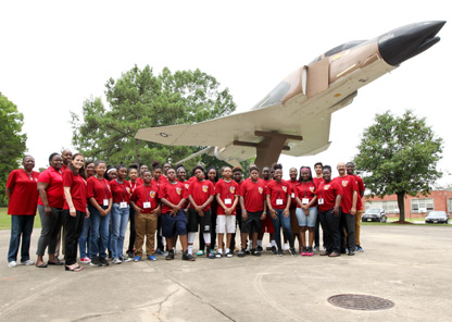 Fly High Summer Program participants standing in front of airplane on campus