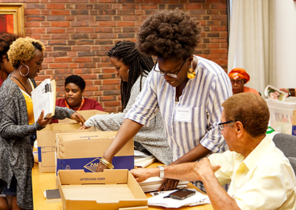 Tuskegee student and students from other colleges examining archival material at Princeton