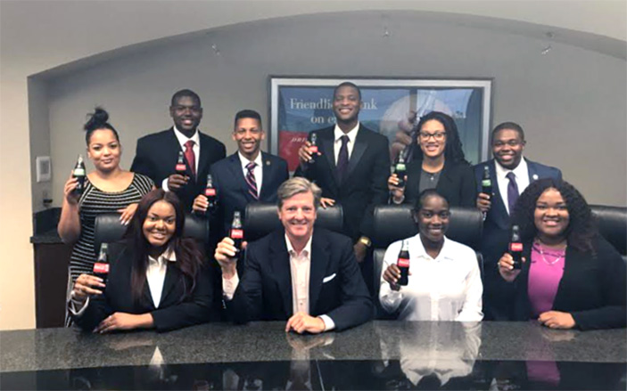 "Coca-Cola UNITED Vice President Bo Taylor with the 2017 ""Pay it Forward"" interns"