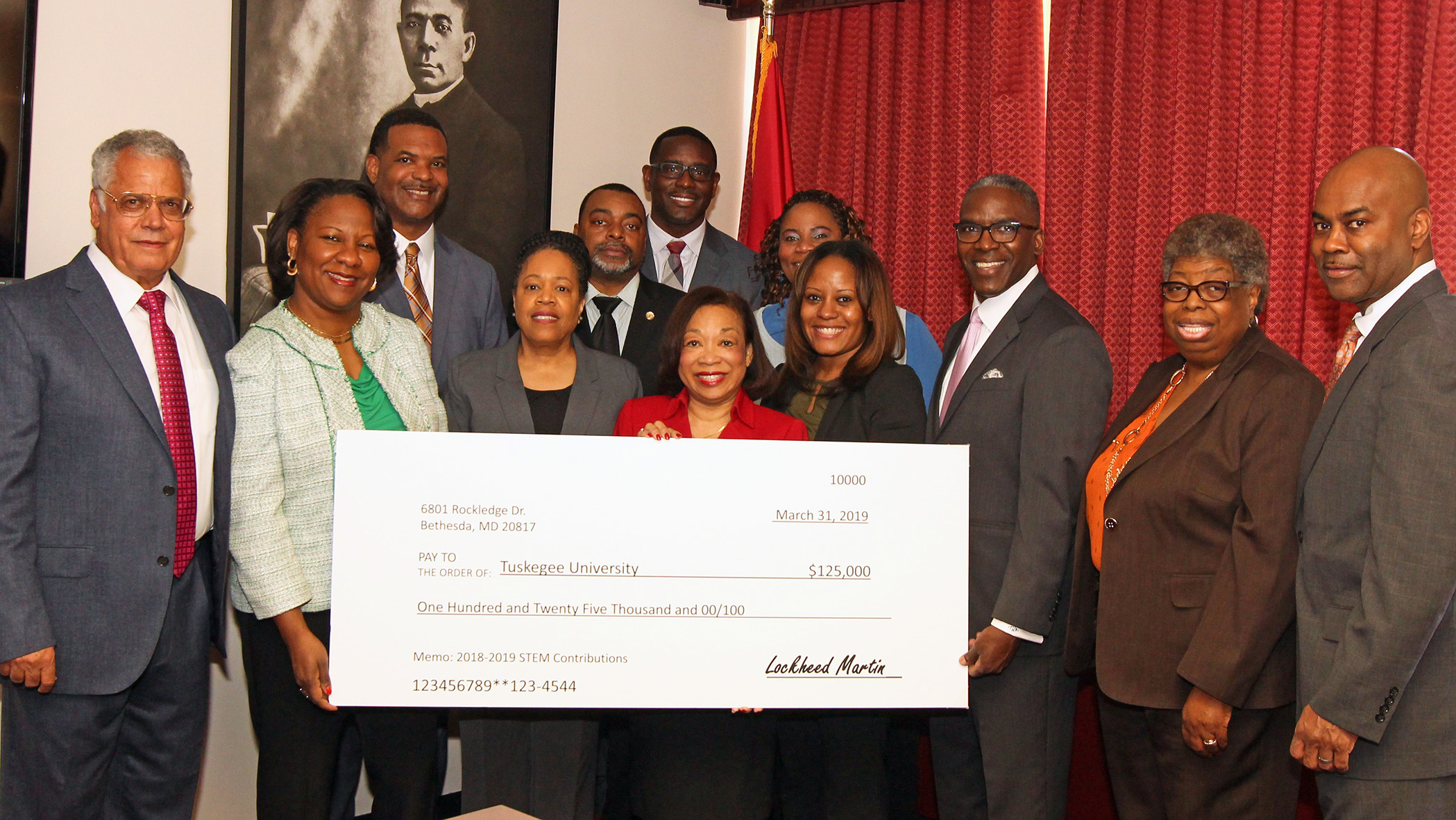 Tuskegee University President Dr. Lily McNair and university officials accept check from Lockheed Martin representatives