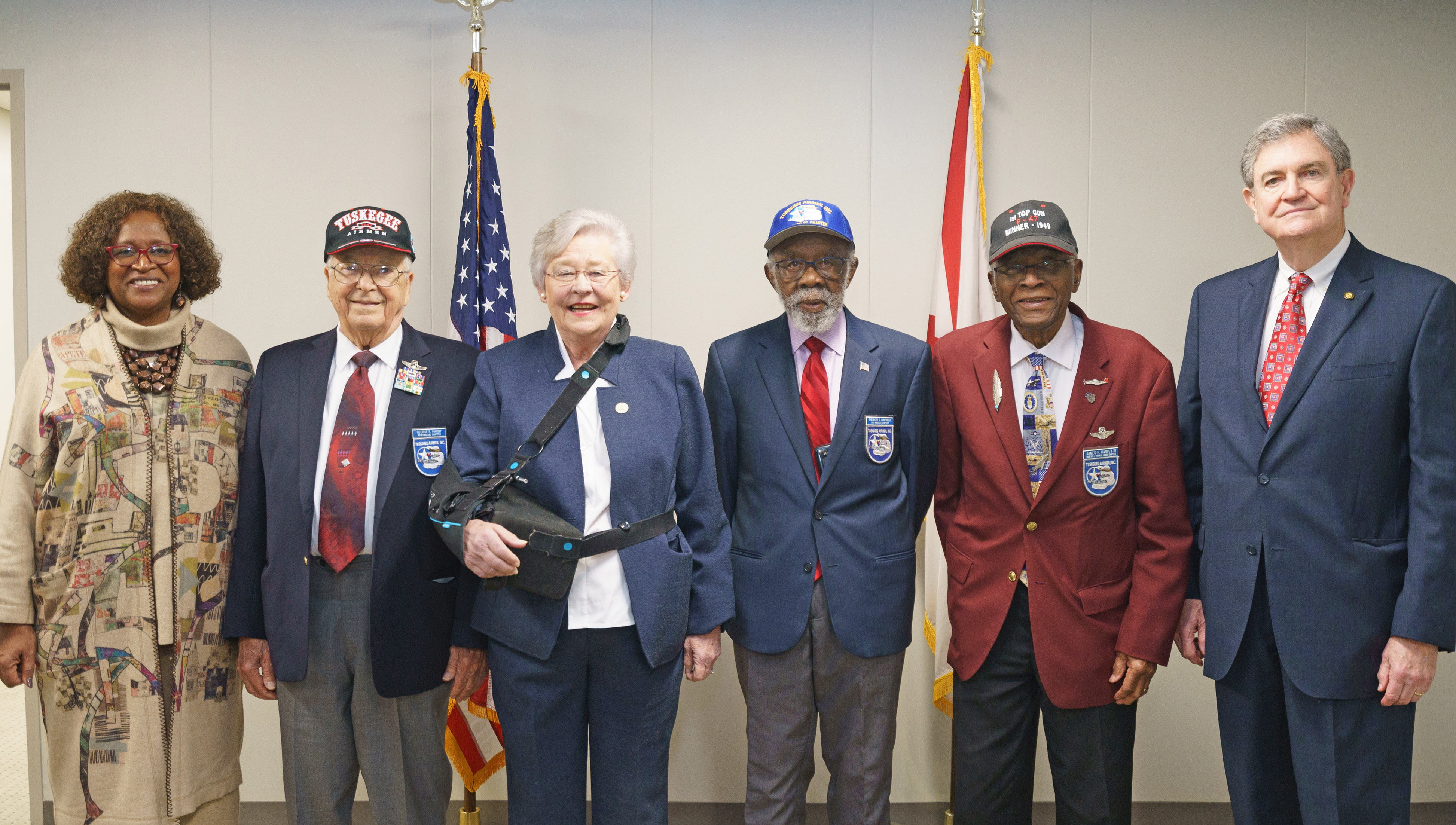 On March 5, Alabama celebrated the Tuskegee Airmen legacy through a joint session of the Alabama legislature, which included (left to right) Rep. Pebblin Warren, Lt. Col. (Ret.) George Hardy, Gov. Kay Ivey, Lt. Col. (Ret.) James Harvey, Lt. Col. (Ret.) Ted Lumpkin, and Sen. Billy Beasley. (Credit: Governor's Office/Sydney A. Foster)