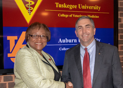 Dr. Ruby Perry and Dr. Calvin Johnson shake hands