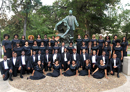 TU Golden Voices Choir pose at BTW statue