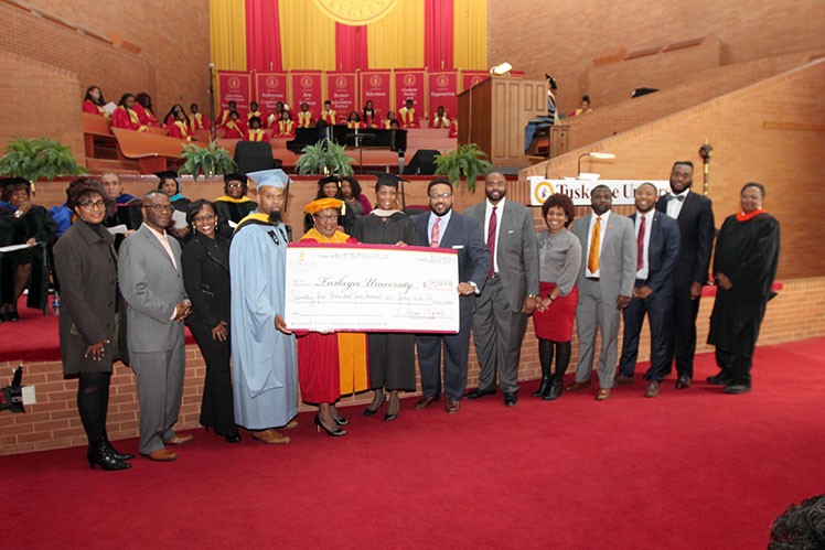 School officials accept Alumni check donation