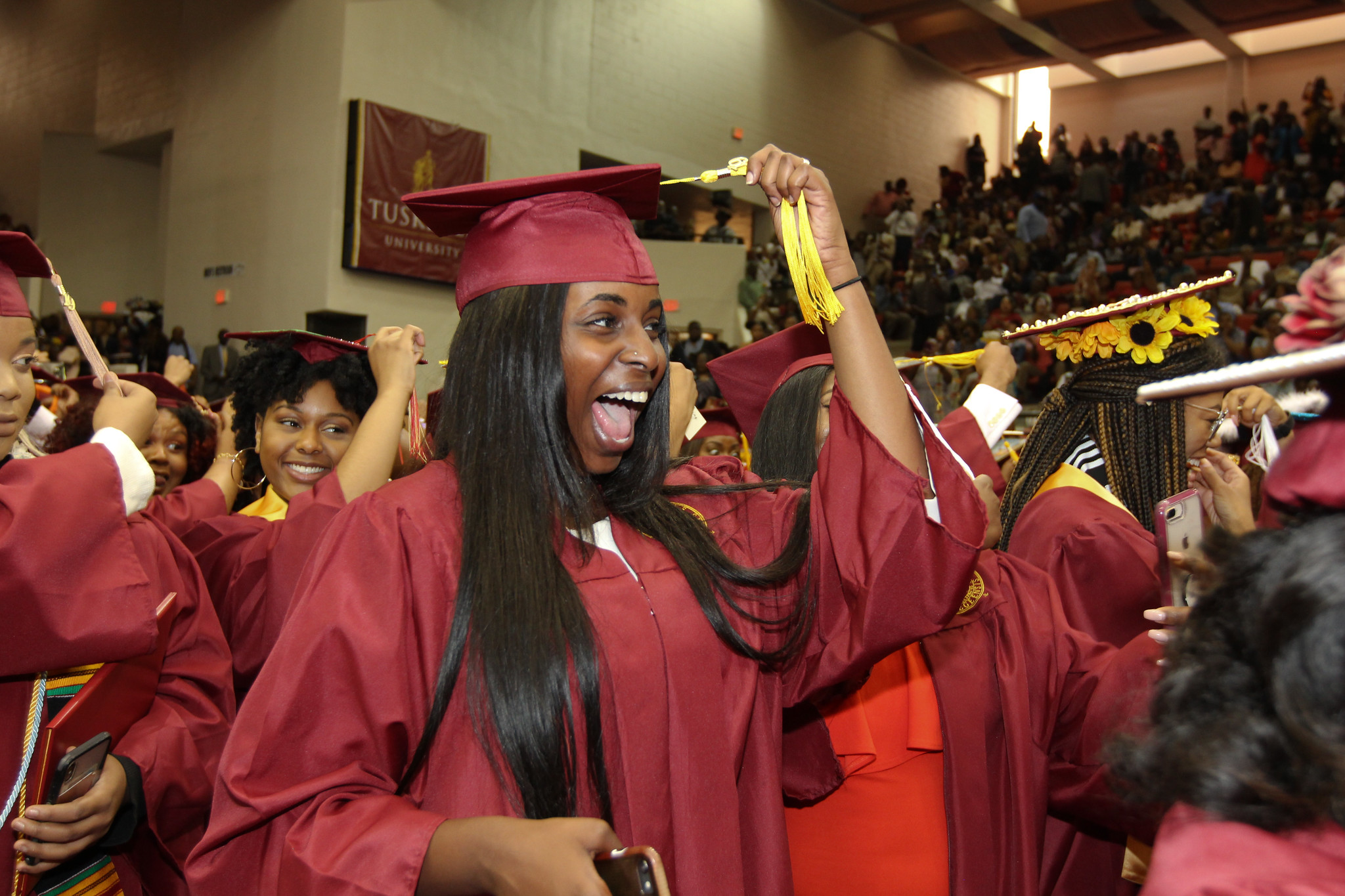 Graduates turn tassels, to become official alumni of Tuskegee University.