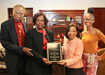 Armstead and Patricia Young, President Dr. Lily D. McNair and granddaughter Taslyn Ware.