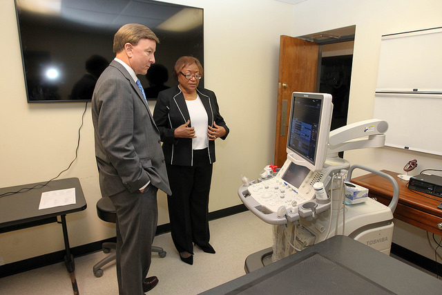 Rep. Mike Rogers and Dr. Ruby Perry view equipment in Vet. Med. Lab.