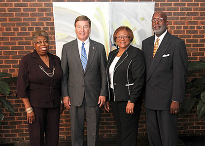 Standing in Patterson Hall are Dr. Roberta Troy, Rep. Mike Rogers, Dr. Ruby Perry, and Dr. Charles Smith