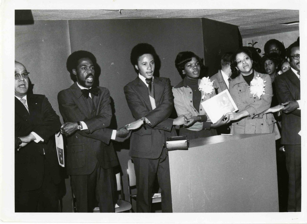 Tuskegee University President Luther H. Foster singing with students; ca. 1968. Courtesy of the Tuskegee University Archives, P.H. Polk Collection, 2017.
