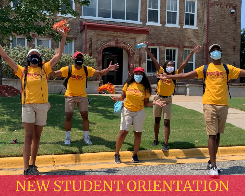 NSO student leaders in yellow t-shirts pose for picture
